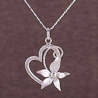 Sterling silver heart pendant necklace, 'Flowering Rapture' - 925 Sterling Silver Floral Heart Pendant Necklace from Peru