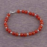 Carnelian beaded bracelet, 'Exotic Glow' - Carnelian and Sterling Silver Beaded Bracelet from Peru