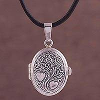 Sterling silver locket necklace, 'Memory World' - Sterling and Leather Floral Heart Locket Necklace from Peru
