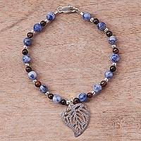 Sodalite and tiger's eye beaded bracelet, 'Mystic Leaf' - Sodalite and Tiger's Eye Beaded Leaf Bracelet from Peru