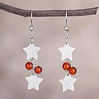 Carnelian dangle earrings, 'Racing Stars' - Carnelian and Silver Star-Shaped Dangle Earrings from Peru