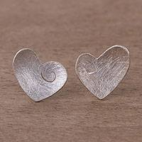 Sterling silver stud earrings, 'Spiraling Hearts' - Heart Shaped Sterling Silver Stud Earrings from Peru