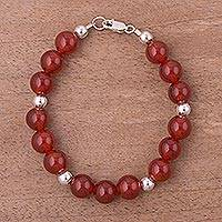 Carnelian beaded bracelet, 'Radiant Orbs' - Artisan Crafted Carnelian Bracelet with Silver from Peru