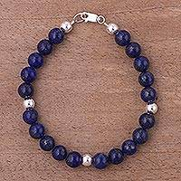 Lapis lazuli beaded bracelet, 'Radiant Orbs' - Lapis Lazuli and Sterling Silver Bracelet from Peru