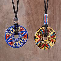 Ceramic pendant necklaces, 'Nocturnal Feast' (pair) - Yellow and Blue Ceramic Pendant Necklaces from Peru (pair)
