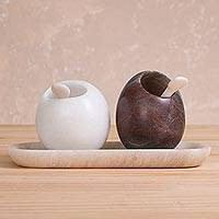 Huamanga stone salt and pepper set, 'Enchanted Eggs' - Handcrafted Huamanga Stone Salt and Pepper Set from Peru