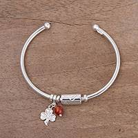 Carnelian and sterling silver charm cuff bracelet, 'Fortune Smiles in Carnelian' - Sterling Silver Clover Charm Carnelian Bead Cuff Bracelet