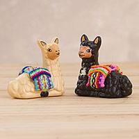 Ceramic figurines, 'Relaxing Friends' (pair) - Hand Crafted Ceramic Seated Beige and Black Llamas (Pair)