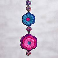 Reversible crocheted pendant necklace, 'Floral Downpour' - Colorful Reversible Flower Hand Crocheted Pendant Necklace
