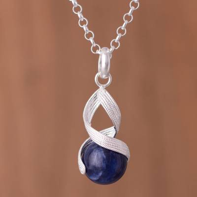 Sodalite pendant necklace, 'With a Twist' - Handcrafted Sodalite and Sterling Silver Pendant Necklace