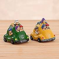 Ceramic figurines, 'Colorful Andean Taxis' (pair) - Handcrafted Colorful Crowded Taxi Ceramic Figurines (Pair)