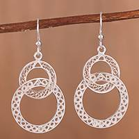 Sterling silver filigree dangle earrings, 'Gleaming Loops' - Gleaming Sterling Silver Filigree Circles Dangle Earrings