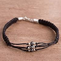 Hematite wristband bracelet, 'Dark Elegance' - Hand-Braided Cotton and Hematite Bracelet from Peru