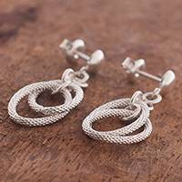 Sterling silver dangle earrings, 'Textured Rings' - Textured Sterling Silver Dangle Earrings from Peru