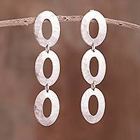 Sterling silver dangle earrings, 'Oval Dimension' - Hammered Oval Sterling Silver Dangle Earrings from Peru