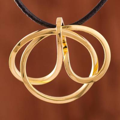 Gold plated copper pendant necklace, 'Amazon Knot' - Knot-Shaped Gold Plated Copper Pendant Necklace from Peru