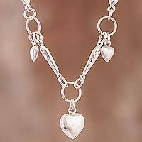 Sterling silver pendant necklace, 'Rain of Hearts' - Heart Motif Sterling Silver Pendant Necklace from Peru