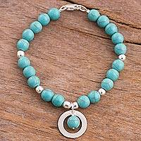 Reconstituted turquoise beaded bracelet, 'Beautiful Planets' - Reconstituted Turquoise Beaded Bracelet with Charm from Peru
