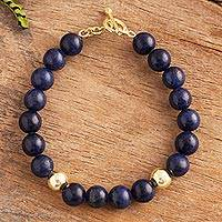 Gold accented lapis lazuli beaded bracelet, 'Golden Sea' - Gold Accented Lapis Lazuli Beaded Bracelet from Peru