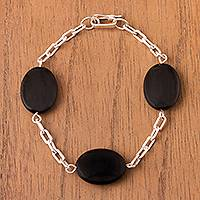 Onyx station bracelet, 'Chic Ovals' - Oval Onyx Station Bracelet Crafted in Peru