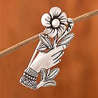 Silver brooch, 'Natural Universe' - Peruvian Silver Brooch of a Hand Clutching a Flower