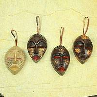 Wood ornaments, 'Happy Masks' (set of 4) - Wood ornaments (Set of 4)