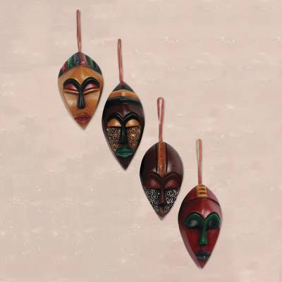 Wood ornaments, 'Celebration Masks' (set of 4) - African Wood Christmas Ornaments (Set of 4)