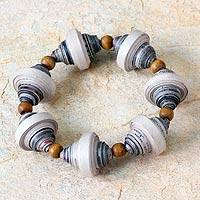 Recycled paper stretch bracelet, 'Golden Dawn' - Handcrafted Modern Recycled Paper Beaded Bracelet