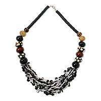 Coconut shell and bull horn beaded necklace, 'Zebra' - Coconut shell and bull horn beaded necklace
