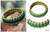 Bangle bracelet, 'Queen Amina in Gold and Green' - Bangle Bracelet from Africa thumbail