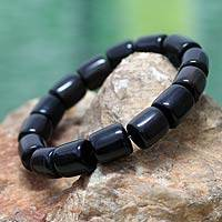 Bull horn stretch bracelet, 'Korleki in Black' - Fair Trade Bull Horn Beaded Bracelet