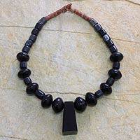 Horn and bauxite pendant necklace, 'Willing Helper' - Horn and bauxite pendant necklace