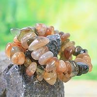 Beaded stretch bracelets, 'Orange Odo Tintine' (pair) - Beaded stretch bracelets (Pair)