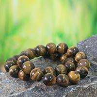 Tiger's eye beaded stretch bracelets, 'Esombo' (pair) - Tiger's eye beaded stretch bracelets (pair)