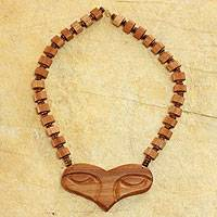 Wood pendant necklace, 'In the Eyes of the Beholder' - Handcrafted Wood Bead Necklace from Africa