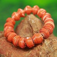 Recycled paper stretch bracelet, 'Taifa Tangerine' - Orange Handmade Bracelet with Recycled Paper Beads
