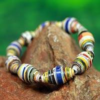 Recycled paper stretch bracelet, 'Storyteller' - Multicolor Handmade Bracelet with Recycled Paper Beads