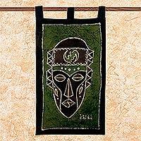 Cotton batik wall hanging, 'Gye Nyame Mask' - Handcrafted Cotton Batik Green Wall Hanging from Ghana