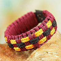 Men's wristband bracelet, 'Inner Peace' - Men's African Burgundy Hand Woven Cord Bracelet with Yellow