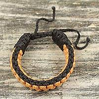 Men's wristband bracelet, 'Awindazi Gold' - Hand Crafted Cord Wristband Bracelet in Gold and Black