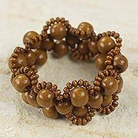 Wood stretch bracelet, 'Sweet Honey Brown' - Handcrafted Wood Beaded Stretch Bracelet from Africa