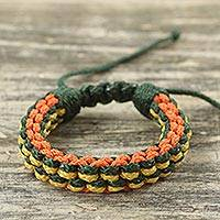 Men's wristband bracelet, 'Tropical Awindazi' - Men's Hand Woven Cord Bracelet in Green Orange and Yellow