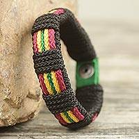 Men's wristband bracelet, 'Reggae Kente' - Men's Hand Crafted Cord Wristband Bracelet Reggae Colors