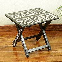 Wood folding accent table, 'Adinkra' - Brown and Cream Wood Folding Table with Adinkra Symbols