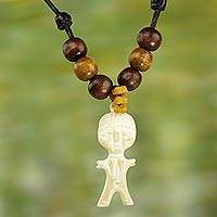 Wood and bone pendant necklace, 'Entranced' - Bone Pendant Necklace with Wood and Glass Beads