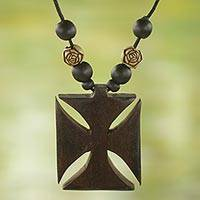 Wood pendant necklace, 'Adinkra Cross' - Ebony Bamboo and Sese Wood Floral Adinkra Pendant Necklace