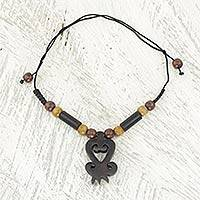 Ebony and bamboo pendant necklace, 'Return' - Ebony and Bamboo Handcrafted Necklace from Ghana