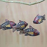 Wood ornaments, 'Little Ghanaian Fish' (set of 4) - Ghana Artisan Crafted Fish Theme Ornaments (Set of 4)