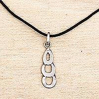 Sterling silver pendant necklace, 'Curvaceous Cascade' - Ghana Handcrafted Sterling Silver Necklace