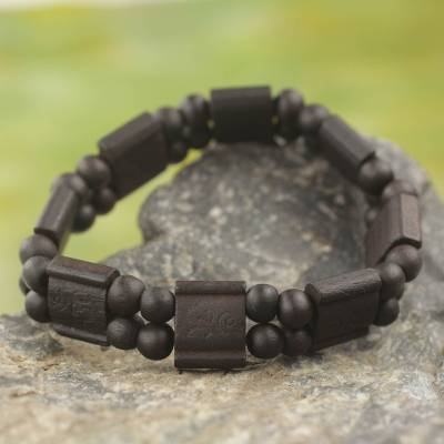 Wood stretch bracelet, 'Black Radiance' - Artisan Crafted Sese Wood Stretch Bracelet in Black